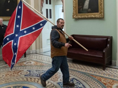 A supporter of President Trump carries a Confederate flag through the Capitol Rotunda, Jan. 6, 2021. (Photo/JTA-Saul Loeb-AFP via Getty Images)