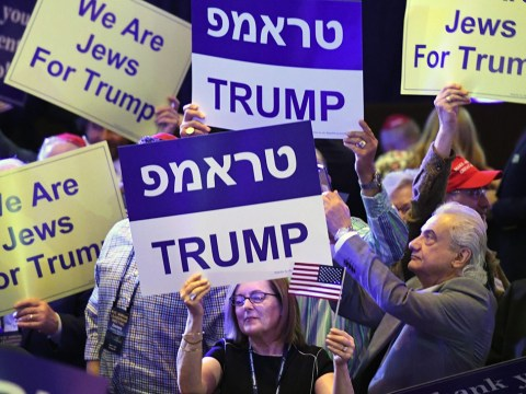 Attendees at the Republican Jewish Coalition's annual leadership meeting hold up signs while waiting to see President Donald Trump speak, April 6, 2019. (Photo/JTA-Ethan Miller-Getty Images)