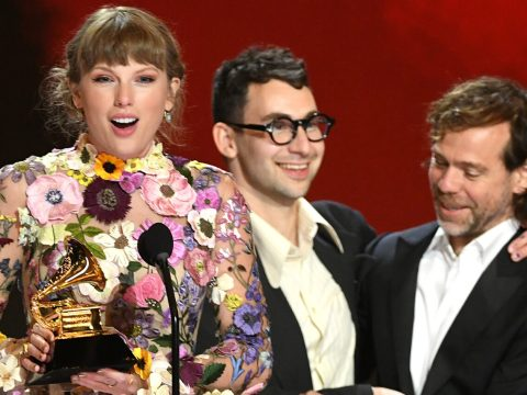 """Taylor Swift, Jack Antonoff and Aaron Dessner accept the Album of the Year award for """"Folklore."""" (Photo/JTA-Kevin Winter-Getty Images for The Recording Academy)"""