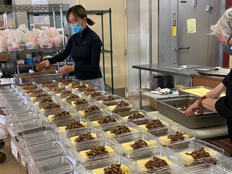 Volunteers help prepare meals for Cindy Gershen's program.