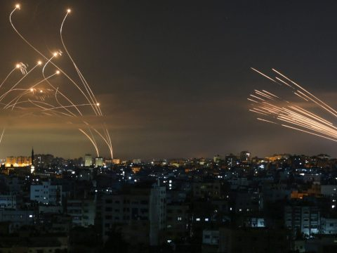 Israel's Iron Dome missile defense system (left) intercepts rockets fired by Hamas toward southern Israel from the Gaza Strip, May 14, 2021. (Photo/JTA-Anas Baba-AFP via Getty Images)