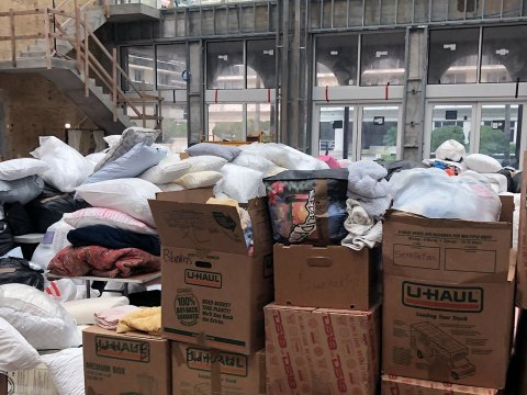 A social hall under construction in The Shul, a synagogue in Surfside, Florida, is piled high with donations for newly homeless families less than 18 hours after a nearby building collapsed, June 25, 2021. (Photo/JTA-Ron Kampeas)