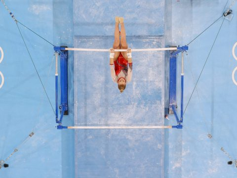 Lilia Akhaimova of Team Russia competes on uneven bars at the Tokyo Olympics, July 25, 2021. (Photo/JTA-Laurence Griffiths-Getty Images)