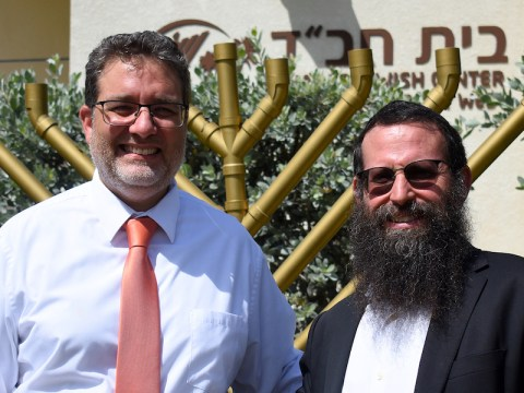 Sam Kaufman, vice mayor of the city of Key West, left, and Rabbi Yaakov Zucker stand in front of the Chabad Jewish Center of the Florida Keys & Key West. (Photo/Larry Luxner)