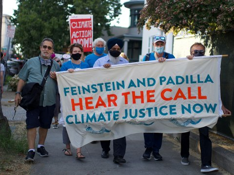 """Demonstrators at the """"Make a Holy Noise for Climate Change"""" demonstration on Aug. 25 in San Jose as they march to the federal building. (Photo/George Barahona)"""