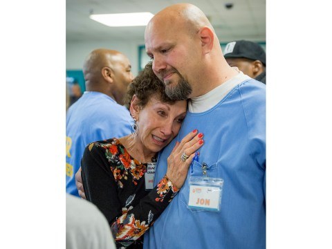 Jon Grobman hugs his mother, Diane Grobman, at a Paws 4 Life graduation ceremony, during which he first received the news that his own life sentence might be commuted. (Photo/JTA-Courtesy of Rita Earl Blackwell)