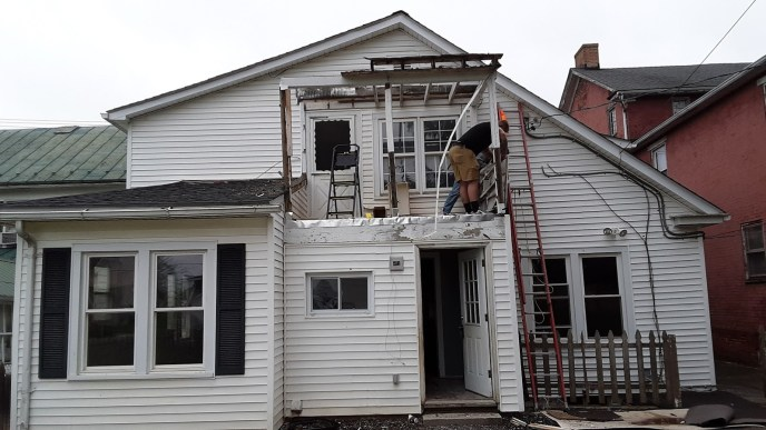 Executing the demolition during this exterior construction by Manchester MD 21088 contractor JWE Remodeling and Roofing