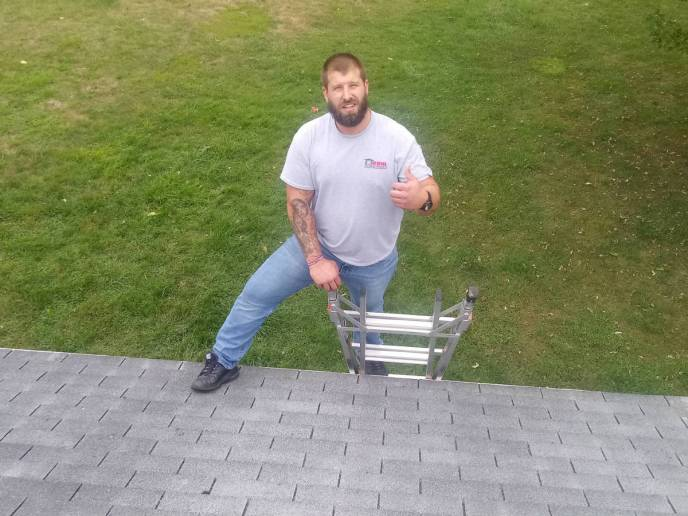 Our owner Jeff Erb performing an emergency roof inspection for leaking and damaged roofing in Hanover PA