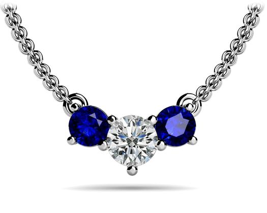 custom Three stone pendant with diamond center and sapphire sides in 14 karat white gold