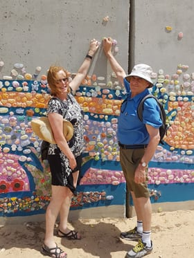 Leonie and Luis Fleiszig at the Path to Peace Wall near Gaza