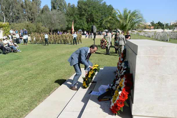 Abassador Dave Sharma lays a wreath