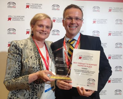 Rhonda Bradley, Director of Business Services, and Alasdair MacDonald, Customer Assurance Manager, with the award.
