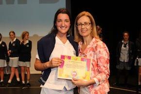 Gabrielle Upton (rt) presents a certificate