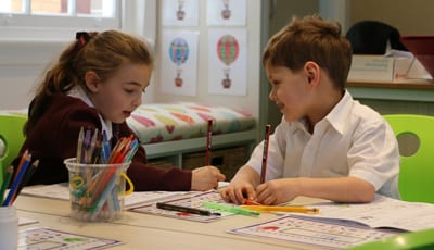 Lara Isenberg and Max Negrine working together in their new classroom