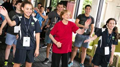 Maccabi youth and Jewish Care residents enjoy a Zumba class in the Montefiore Homes Community Residence Plaza.