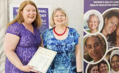 Councillor Linda Kelly presents the award to Judy Singer