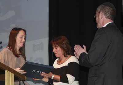 New president Amy Hershan joins Rabb James Kennard is presenting a gift to retiring president Lisa Kennett