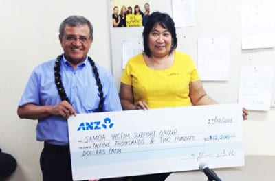 Ambassador Tzur presents the cheque to Mrs Lina Chang, President of the Samoa Victim Support Group