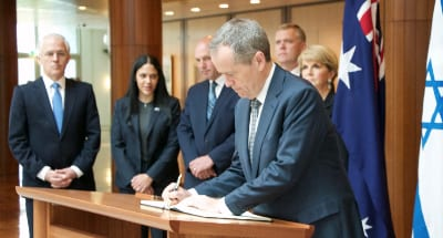 Leader of the Opposition Bill Shorten signs the book