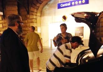 Shane and Teresa pack their things into Rabbi Kastel's vehicle