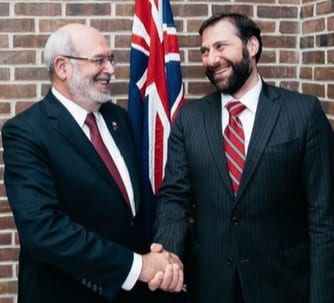 Sir Peter Gluckman being congratulated by Dr Vaughan Turekian Science and Technology Advisor to the U.S. Secretary of State   Photo: Jonathan Seffert NZ Embassy, Washington