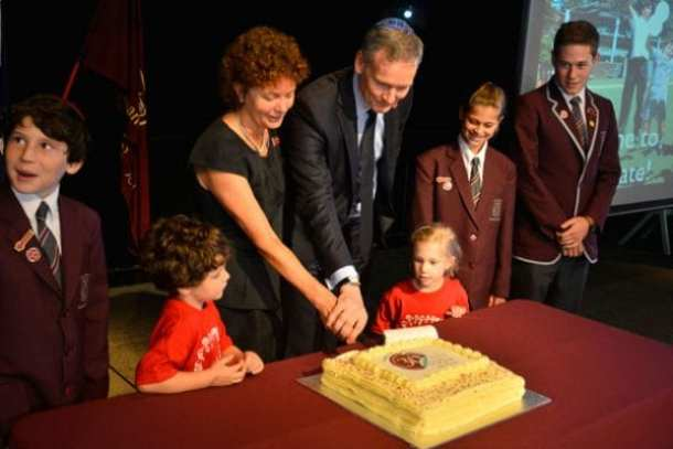 •Emanuel students are joing by the Principal, Anne Hastings and Board Now! President, Grant McCorquodale in cutting the celebratory cake.