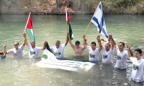 """Mayors, community reps and youth from Israel, Palestine and Jordan """"Jump in the Jordan"""" calling for their governments to step up on the rehabilitation of the river"""