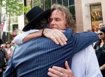 Ken Johnsopn hugs Rabbi Levi Wolff   Photo: Henry Benjamin/J-Wire