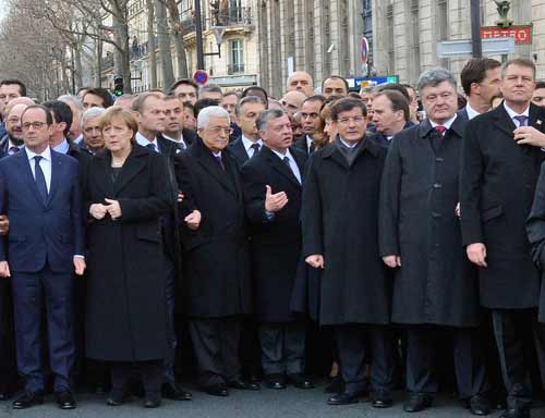 Palestinian Authority President Mahmoud Abbas—third from left in the front row, sandwiched between German Chancellor Angela Merkel and Jordan's King Abdullah at the Jan. 11 solidarity march against terrorism in Paris—condemned the attack on the French satirists at Charlie Hebdo, but recently jailed and tortured a Palestinian satirist. Credit: Haim Zach/GPO.