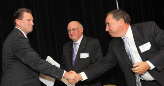 Premier Nathan Rees shakes Ambassador Rotem's hand while SZC president Frank Levy looks on
