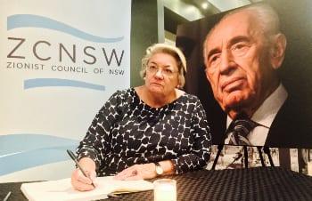 Waverley Mayor Sally Betts signing the book