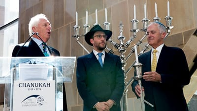 Cantor Shimon Farkas, Rabbi Levi Wolff and Prime Minister Malcolm Turnbull holding the Shammos Photo: Henry Benjamin/J-Wire
