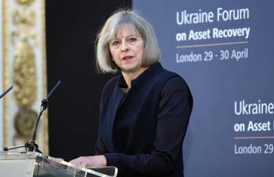 Former British Home Secretary Theresa May—who is now the U.K.'s prime minister—speaks at the Ukraine Forum on Asset Recovery in London on April 29, 2014. Credit: Foreign and Commonwealth Office via Wikimedia Commons.