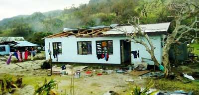 A damaged home on Vuma