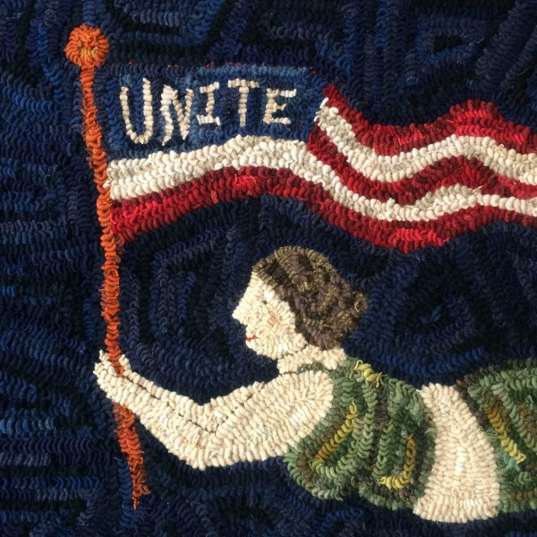 Unite, carried high by a mermaid flag bearer.