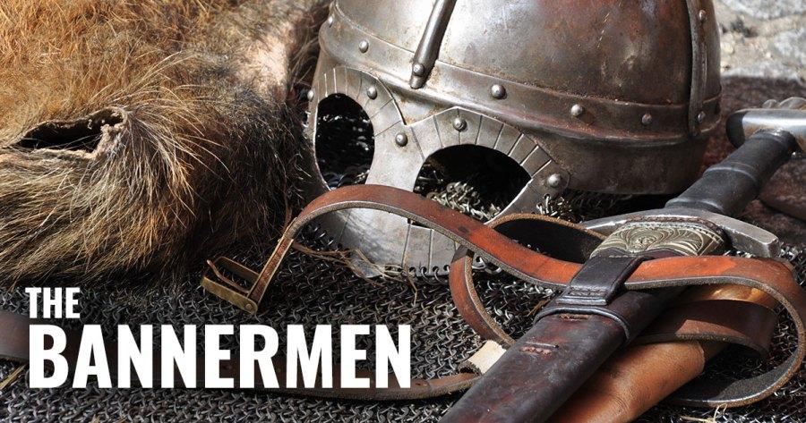 A helmet and sword lying on armor.