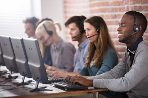 Customer service agents at their computers