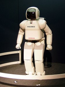 ASIMO is a humanoid robot created by Honda. Standing at 130 centimeters and weighing 54 kilograms, the robot resembles a small astronaut wearing a backpack and can walk on two feet in a manner resembling human locomotion at up to 6 km/h. ASIMO was created at Honda's Research & Development Wako Fundamental Technical Research Center. Taken by Gnsin at Expo 2005, in Japan