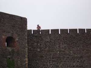 Carrickfergus castle. This red coat is keeping his weapon pointed at us, just in case we try anything.