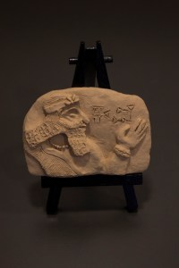 Small tablet with relief profile of King Hammurabi with cuneiform signature