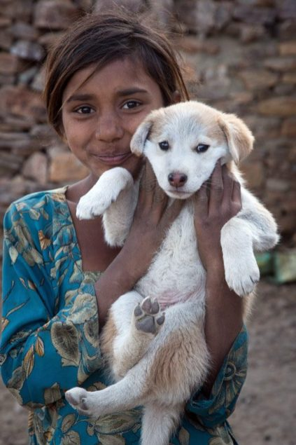 An Indian girl with a puppy at TOLFA