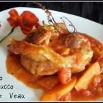 recette italienne de l'osso bucco de viande de veau en sauce tomate avec des carottes découpés en sifflet