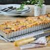 Tarte madeleine - Recette de tarte madeleine aux pêches bio
