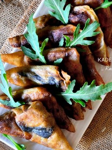 Samoussas aux restes de poularde, farce au foie gras et roquette