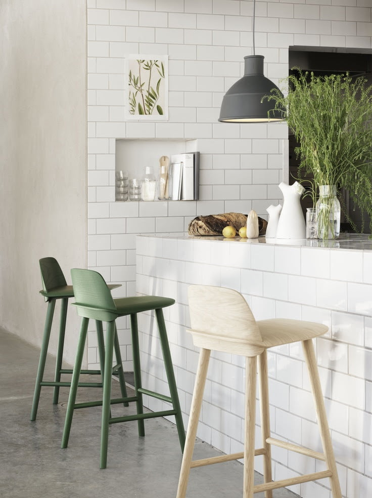 Give your kitchen a clean and fresh vibe with green accents
