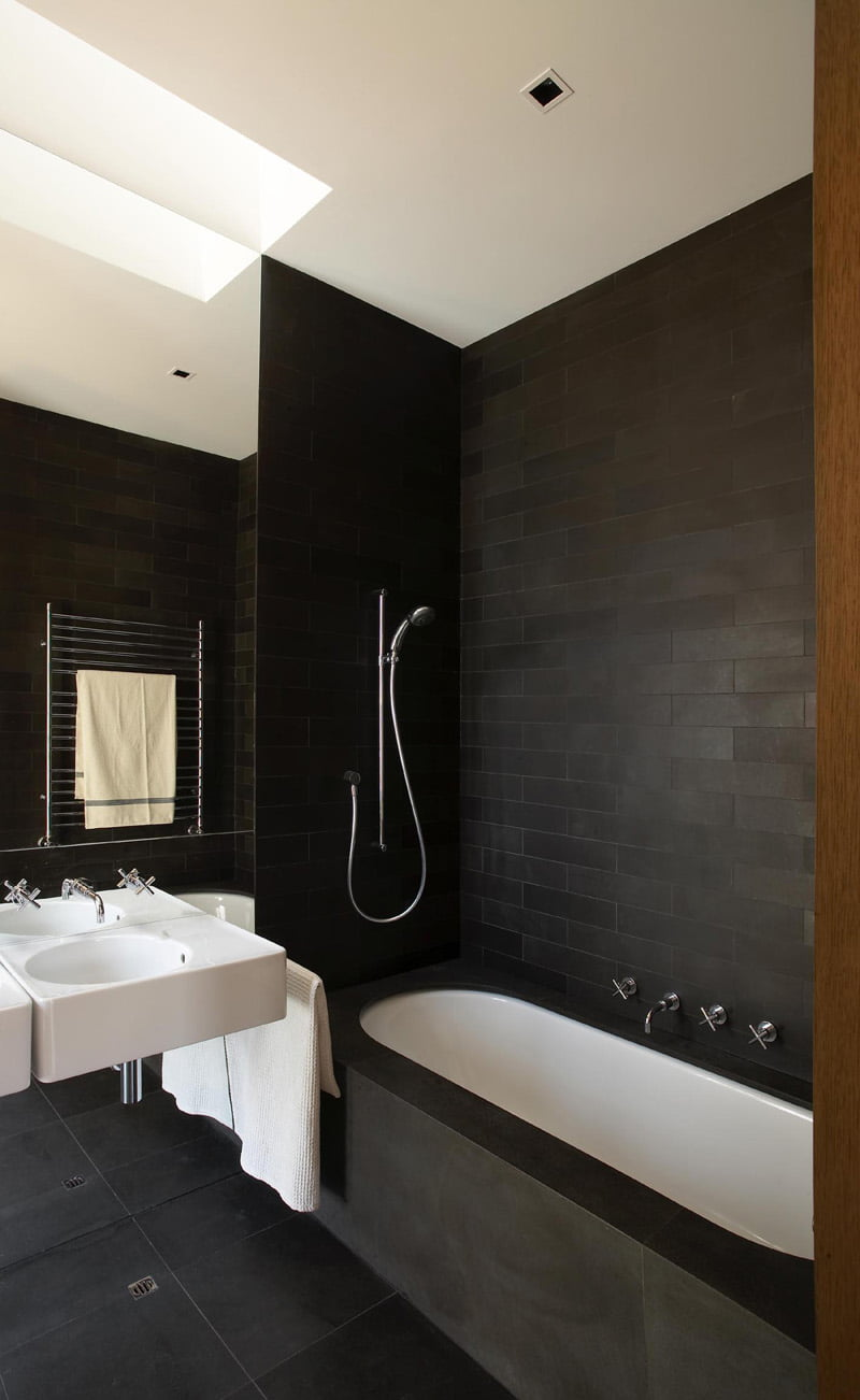 black and white bathroom is from a house in Sydney, Australia, designed by Rice Design