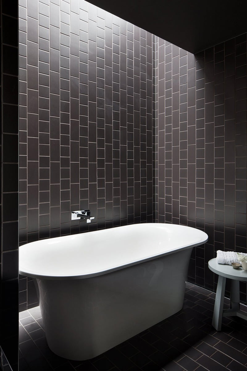black and white bathroom is in a home in Melbourne, Australia, designed by Bower Architecture