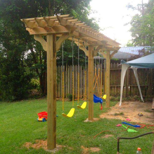Swing set in backyard pergola