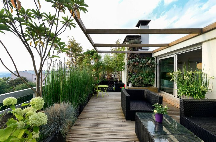 Rooftop outdoor deck rattan furniture and cozy sofa seats