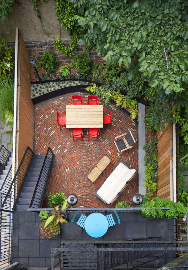 bright colors furniture and circular brick pattern in back patio